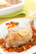 Roast chicken with red and green peppers Stock Photos