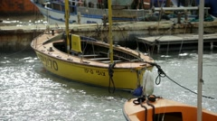 Sway storm boat in sea waves old fishing harbor port in Jaffa port Stock Footage