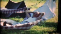 1861 - grandpa relaxes in the hammock - vintage film home movie Stock Footage