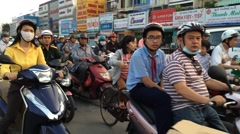 View of crazy traffic in Saigon city in Nguen Oanh street Stock Footage