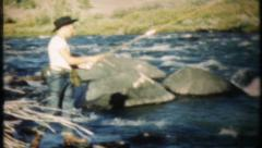 1860 - fly fishing on fast moving river - vintage film home movie Stock Footage