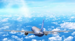 Commercial jet airplane flies at high altitude above the clouds. Stock Footage