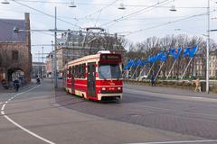 THE HAGUE, THE NETHERLANDS - MARCH 27: Tram near the Dutch parliament buildin - stock photo