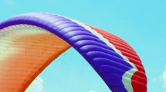 Paraglider Soaring Over Green Hill Stock Footage