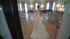 Bride walking on luxurious hall of the old castle. Stock Footage