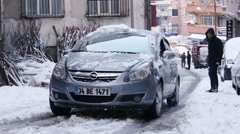 ISTANBUL, TURKEY - FEBRUARY 2015: Car stuck, spinning, snowy streets Stock Footage