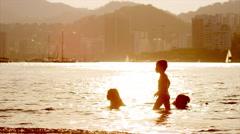 Children swim in the bay in Rio de Janeiro. Stock Footage