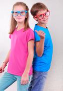 playful brother and sister have fun - stock photo