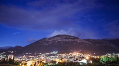 4k time lapse of a mountain town from twilight till night 24p Stock Footage