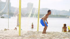 Brazilian man attempts to block a soccer goal. Stock Footage