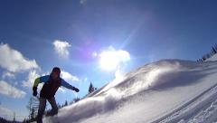 Snowboarder spraying snow into camera, slow motion, 120 fps HD Stock Footage