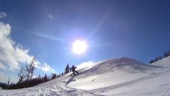 Snowboarder spraying snow into camera, slow motion, 120 fps HD - stock footage