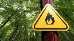 Fire danger sign on the tree - stock illustration