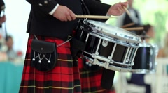 Close-up. Musician in a kilt playing the Scottish reel, raising knees - stock footage