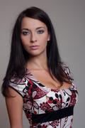 Brunet girl in color dress Stock Photos