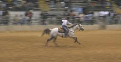 Stock Video Footage of Cowgirl Barrel Racing in Rodeo competition