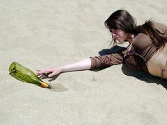 Thirsty girl reaching at desert - stock photo
