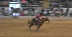 Black Cowgirl Barrel Racing in rodeo competition Stock Footage