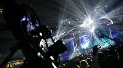 Television production on the set of a large rock concert - stock footage