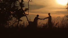 guy and girl dancing at sunset - stock footage