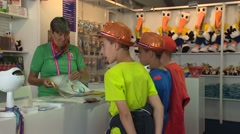 Young Boy shopping  - market place Stock Footage