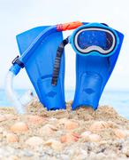 mask, fins and tube in sand background - stock photo