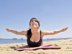 Bikram yoga paorna salabhasana pose frontal view - stock photo