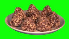 Chocolate sweets with crumbs on saucer Stock Footage