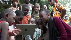 KIGALI, RWANDA JANUARY 2015: African children see a tablet for the first time Stock Footage