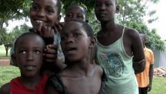 African girl from rural parts of Africa sing a song in front of the camera Stock Footage