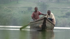 Two African fisherman crossing the river Stock Footage