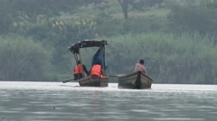 Two African boat crossing the river alongside each other Stock Footage