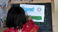 Cute kid doing paintings Stock Footage