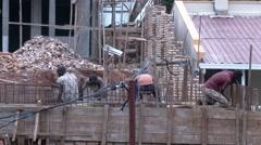 KIGALI, RWANDA JANUARY 2015: Building a house in Africa Stock Footage