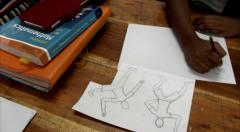 3 african schoolboys practice figure drawing in classroom Stock Footage