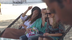 Stock Video Footage of Beautiful Female Tourists Chill Out In The Shade