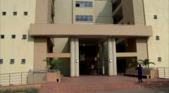 A tilt down of the University of Kigali main building Stock Footage