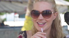 Close Up Of Adorable Young Woman Drinking Chilled Coconut Milk - stock footage