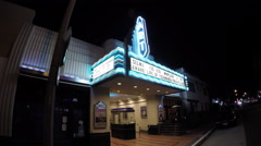 Old Style Retro Neighborhood Movie Theater-Night Stock Footage
