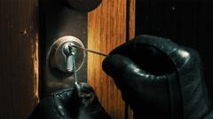 Burglar pick lock frontdoor close-up 1/4 Stock Footage
