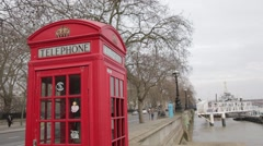 Red Telephone Box by River Thames Stock Footage