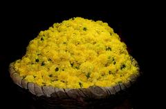 Basket full of yellow flowers at a local flower market Stock Photos