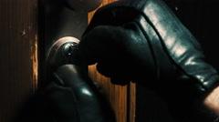 Burglar pick lock frontdoor close-up 2/4 Stock Footage