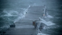 ship dock pier rocking violently in hurricane force rain and wind,Iceland - stock footage