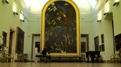Tourists view the The Burial of St. Petronilla painting   in Capitoline Museum. - stock footage