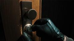 Burglar pick lock frontdoor wide angle 3/4 Stock Footage
