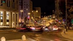 4K time lapse loaded traffic crossroads in downtown of Jerusalem street night Stock Footage
