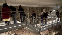 Tourists at the underground ancient Vatican necropolis. Stock Footage