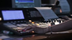 Television director during the live broadcast, switches cameras in the studio - stock footage
