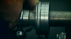 Turner Working With Industrial Lathe. Archival record Stock Footage